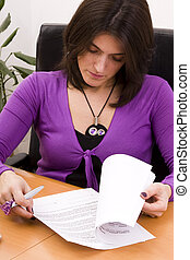 businesswoman signing documents - businesswoman working at...