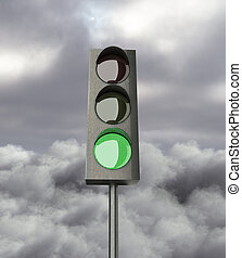 gree color on traffic light on a  sky background