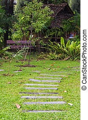 wood pathway in garden entrance to hut