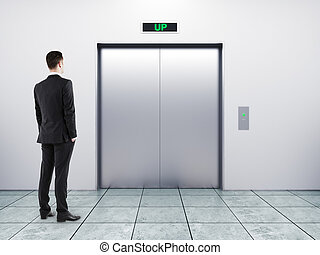 businessman and elevator - businessman and modern elevator...