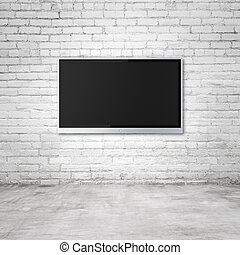 wide screen TV on brick wall in room