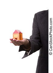 House insurance - woman with her new house on her hands