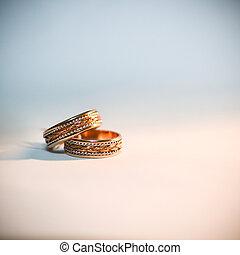 Wedding rings - Golden wedding rings on white background