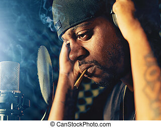rapper with joint in recording booth