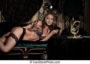 seductress - Attractive young woman alluring in sexy...