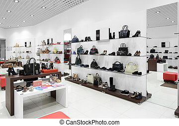 interior of shoe store in modern european mall - bright and...