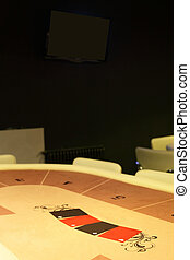 dark and fashionable casino with tables - modern and...