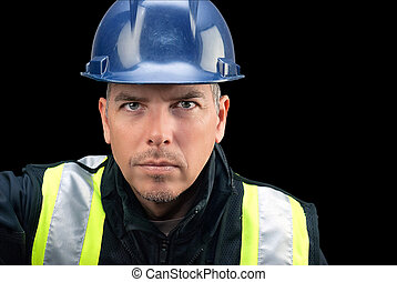 Construction Worker Looks To Camera
