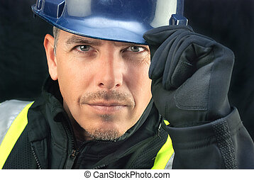 Construction Worker Putting On HardHat