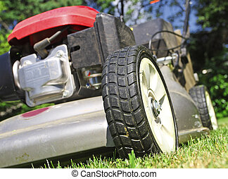 Lawn Mower background - detail of classic Lawn Mower on...