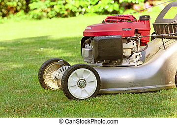Lawn Mower - detail of classic Lawn Mower on green grass...
