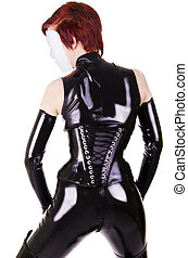 Young masked woman in latex suit