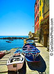 Riomaggiore village street, boats and sea in Five lands,...