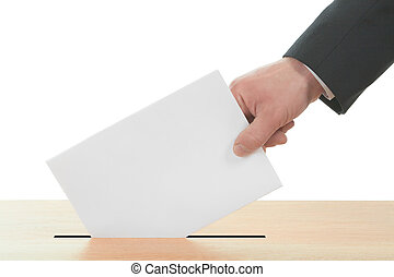 Man's hand down the ballot in the ballot box. Isolated on...