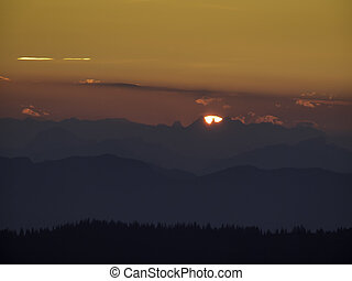 Mountain sunset view - NIght time mountain top with a...