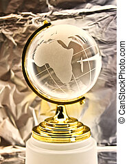 glass globe against a foil