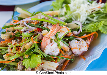 Spicy seafood salad with vegetables. - Spicy seafood salad...