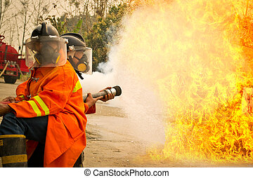 Firemen in action fighting fire during training