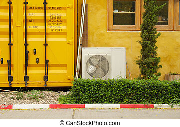 Air compressors are located outside the office.