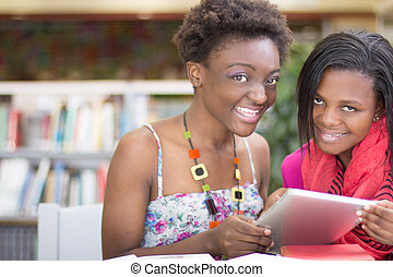 African Students doing research at the library - Student...