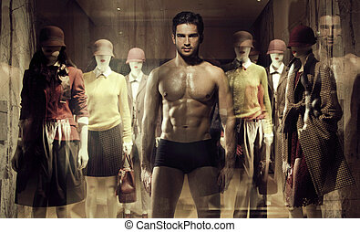 Human mannequin behind the shop window - Human mannequin...