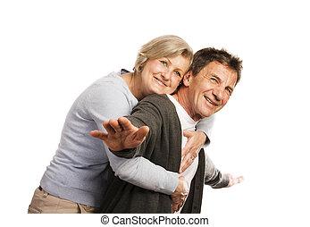 Senior couple - Studio portrait of happy seniors couple...