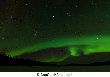 Frozen Lake Laberge Aurora borealis night sky - Green...