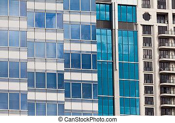 Modern glass-walled highriser building facade - Background...