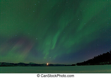 Aurora borealis dance moonrise Lake Laberge Yukon - Rising...