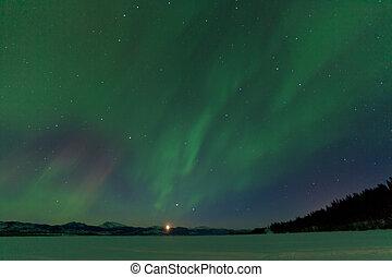 Aurora borealis dance moonrise Lake Laberge Yukon - Rising...