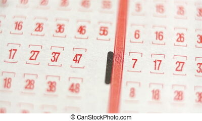 Lottery Ticket Lucky Numbers Macro - Extreme close up of a...