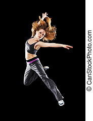 woman dancer dancing modern dance, jump on a black...