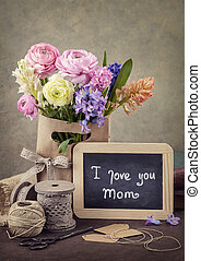 Flowers and a chalk board - Flowers and a black chalk board...