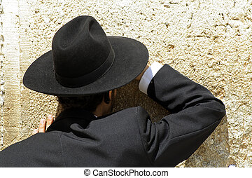Hasidic jew at the wailing western wall, jerusalem, israel