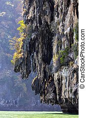 Limestone cliff in sea - Huge limestone cliff in the Phang...
