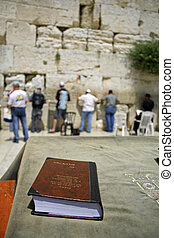 Jewish bible on table, wailing western wall, jerusalem,...