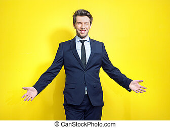 Friendly young businessman in open pose - Friendly and...