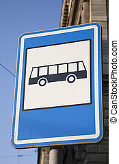 Blue Bus Stop Sign in Urban Setting