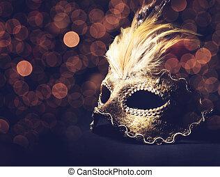 Venetian Mask - Golden venetian mask over black background