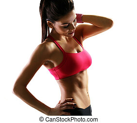 Young beautiful sport woman holding her neck over white...