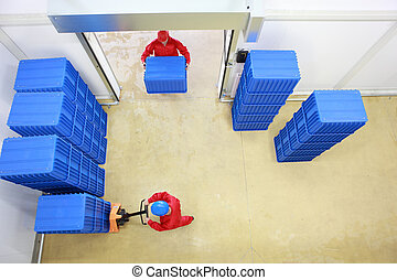 workers in small warehouse - Aerial view of two workers...