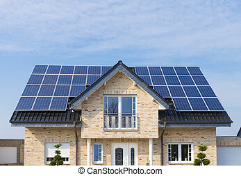 solar panels on roof - new house with solar panels on its...