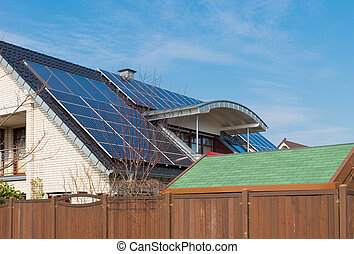 solar panels on roof - modern house with solar panels on its...