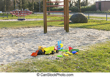 kids playground - empty sandpit with colorful toys