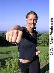 punch - friendly punch - attractive young woman practicing...