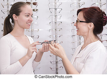 Glasses - Beautiful young female patients at the optician