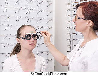 At the Optician - Beautiful young female patients at the...