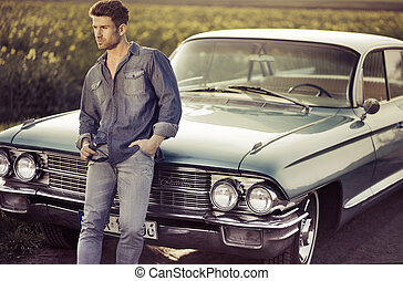 Elegant male model with the retro car - Elegant male model...