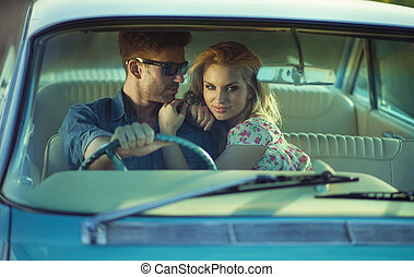 Picture of the retro cuople in the cadillac - Picture of the...