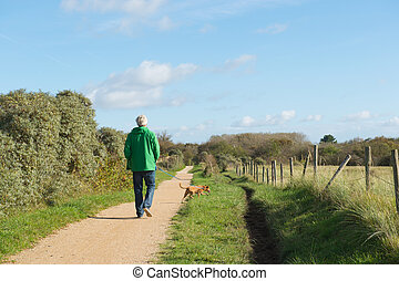 Man walking dog in nature